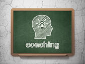 Education concept: Head With Light Bulb and Coaching on chalkboard background — Foto de Stock