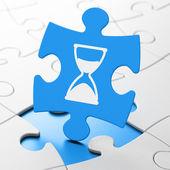 Zeit-Konzept: Sanduhr auf Puzzle-Hintergrund — Stockfoto