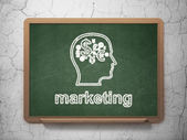 Advertising concept: Head With Finance Symbol and Marketing on chalkboard background — Stock Photo