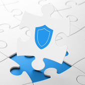 Safety concept: Shield on puzzle background — Stock Photo