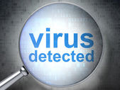 Protection concept: Virus Detected with optical glass — Stock Photo
