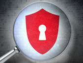 Protection concept: Shield With Keyhole with optical glass on digital background — Stock Photo