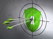 Security concept: arrows in Shield With Keyhole target on wall background — Stock Photo