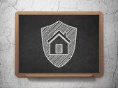 Finance concept: Shield on chalkboard background — Stockfoto