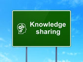 Education concept: Knowledge Sharing and Head With Gears on road sign background — Stock Photo