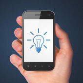 Finance concept: Light Bulb on smartphone — Stock Photo