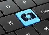 Vacation concept: Photo Camera on computer keyboard background — Stock Photo