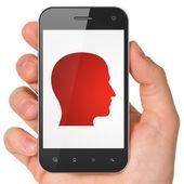 Data concept: Head on smartphone — Photo