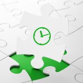 Time concept: Clock on puzzle background — Stock Photo