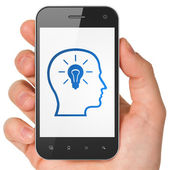 Business concept: Head With Lightbulb on smartphone — Stock Photo