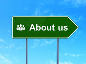 Advertising concept: About Us and Business People on road sign background — Stock Photo