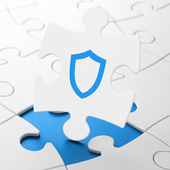 Protection concept: Contoured Shield on puzzle background — Stockfoto