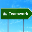 Business concept: Teamwork and Business Team on road sign background — Stock Photo
