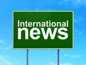 News concept: International News on road sign background — Stock Photo