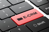 Finance concept: Folder and E-CRM on computer keyboard background — Stock Photo
