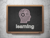 Education concept: Head With Gears and Learning on chalkboard background — Foto Stock
