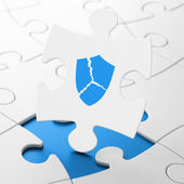 Privacy concept: Broken Shield on puzzle background — Stockfoto