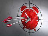Timeline concept: arrows in Alarm Clock target on wall background — Stockfoto