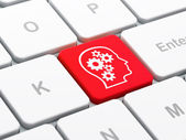 Advertising concept: Head With Gears on computer keyboard background — Stock Photo