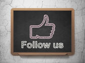 Social media concept: Thumb Up and Follow us on chalkboard background — Stock Photo