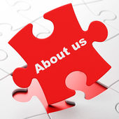 Advertising concept: About Us on puzzle background — Photo