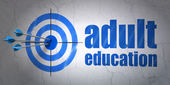 Education concept: target and Adult Education on wall background — Stock Photo
