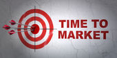 Time concept: target and Time to Market on wall background — Stock Photo