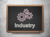 Business concept: Gears and Industry on chalkboard background — Stock Photo