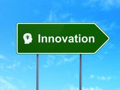 Business concept: Innovation and Head With Light Bulb on road sign background — Stock Photo