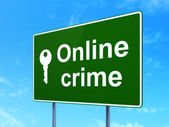 Security concept: Online Crime and Key on road sign background — Zdjęcie stockowe