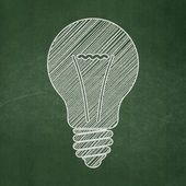 Business concept: Light Bulb on chalkboard background — Stock Photo
