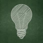 Business concept: Light Bulb on chalkboard background — Stock Photo
