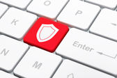 Privacy concept: Shield on computer keyboard background — Stock Photo