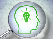 Finance concept: Head With Lightbulb with optical glass on digital background — Stok fotoğraf