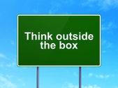 Education concept: Think outside The box on road sign background — Foto de Stock