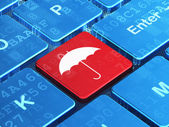 Protection concept: Umbrella on computer keyboard background — Stock Photo