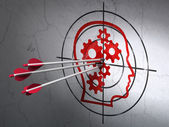 Advertising concept: arrows in Head With Gears target on wall background — Stock Photo