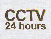 Security concept: CCTV 24 hours on fabric texture background — Stock Photo