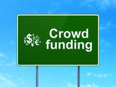 Crowd Funding and Finance Symbol on road sign background — Stock Photo