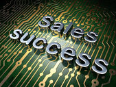 Marketing concept: Sales Success on circuit board background — Stock Photo