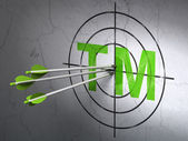 Law concept: arrows in Trademark target on wall background — Stok fotoğraf