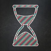 Timeline concept: Hourglass on chalkboard background — Stock Photo