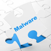 Protection concept: Malware on puzzle background — Stock Photo