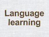 концепция образования: язык обучения на фоне текстуры ткани — Стоковое фото