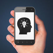 Data concept: Head With Light Bulb on smartphone — Stock Photo