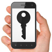 Protection concept: Key on smartphone — Stock Photo