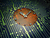 Time concept: Clock on circuit board background — Stock Photo