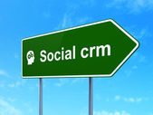 Business concept: Social CRM and Head With Gears on road sign background — Stock Photo