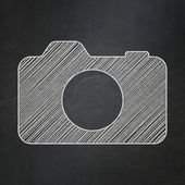 Travel concept: Photo Camera on chalkboard background — Stok fotoğraf
