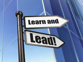 Education concept: sign Learn and Lead! on Building background — Stock Photo